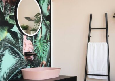 Matt Black and pink bathroom theme with tropical wall paper