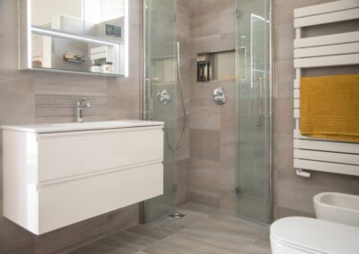 Formosa Showroom shows Bathrooms one with shower and one with free standing toilet, bidet and white towel rail