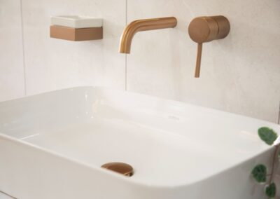 Sink with Bronze tap and soap dish & Bronze bathroom accessories