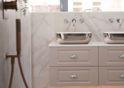 Free standing Double Chrome Sinks - mirror effect reflective sink with dusky pink cabinets