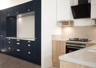 Formosa Showroom Kitchen with dark blue cabinets and Chrome handles