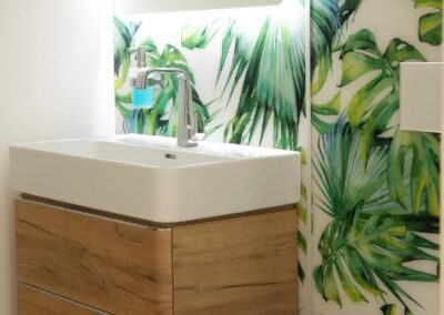 Formosa Showroom Bathroom with freestanding sink with wood drawers and jungle wallpaper