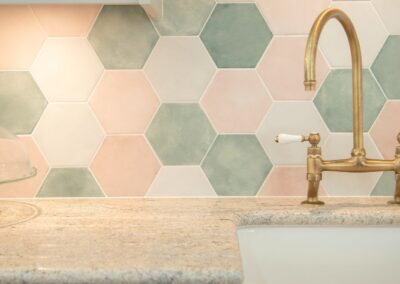 Hexagonal tiles with pinks and greens.