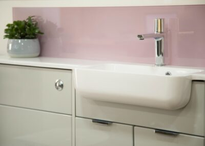Formosa Showroom Bath - Bathroom suite with Pink Glass Splash back Sink and Counter all in one