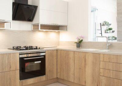 Formosa Showroom Kitchen light Wooden Cabinets Cream Stone Surface