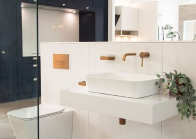 Formosa Showroom Bathroom Sink in white with copper taps, copper flush and accessories